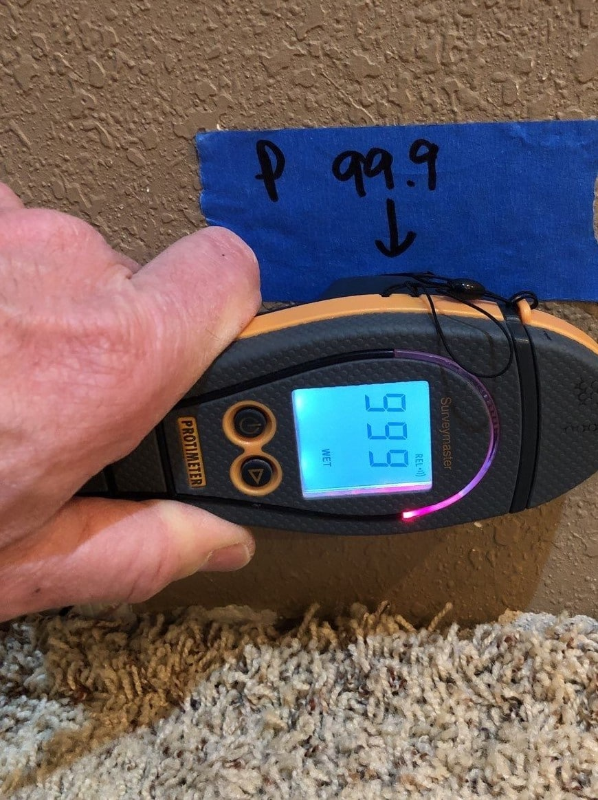Moisture Meter indicating wet wall